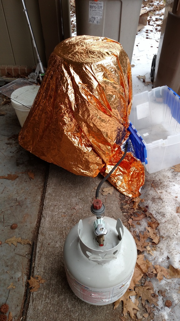 "Wrapped in a blanket and a ""survivior"" blanket to hold mash temperature."
